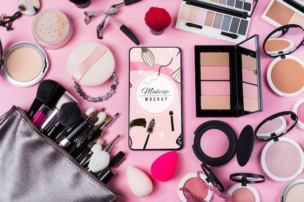 Bovenaanzicht van make-up mock-up concept Gratis Psd
