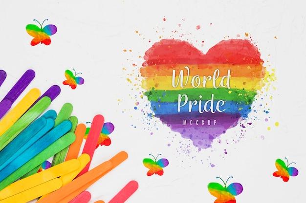 Bovenaanzicht van regenboog gekleurd hart voor trots Gratis Psd