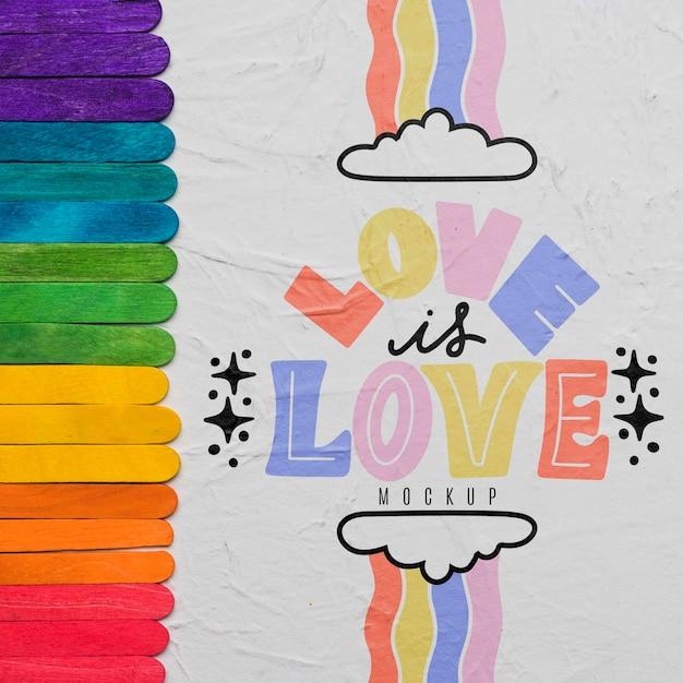 Bovenaanzicht van regenboogkleuren voor trots met liefde Gratis Psd