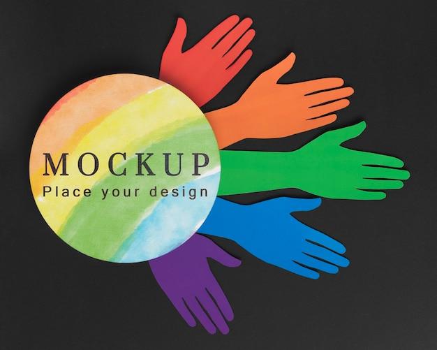 Bovenaanzicht van regenboogkleurige handen voor diversiteit Gratis Psd