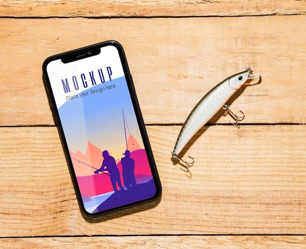 Bovenaanzicht van smartphone met visaas Gratis Psd