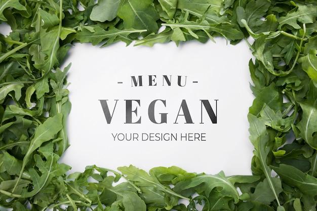 Bovenaanzicht veganistisch menu met rucola Gratis Psd