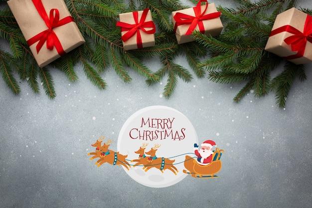 Bovenaanzicht vrolijk kerstfeest en kerst pijnboombladeren Gratis Psd