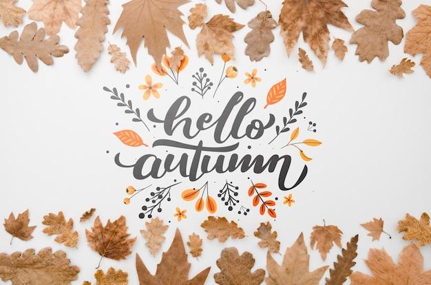 Bruine bladeren framing hallo herfst belettering Gratis Psd
