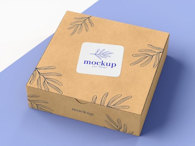 Caja de cartón con maqueta de pegatina PSD gratuito