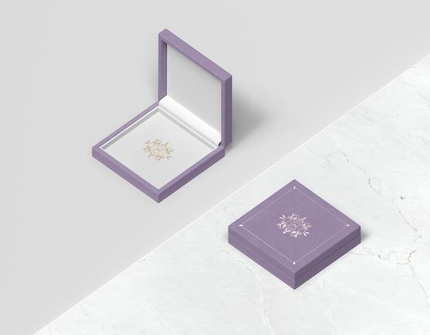 Caja de regalo violeta plana con tapa PSD gratuito