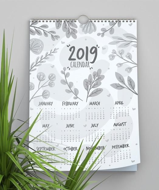 Calendario con modello di sfondo di foglie Psd Gratuite
