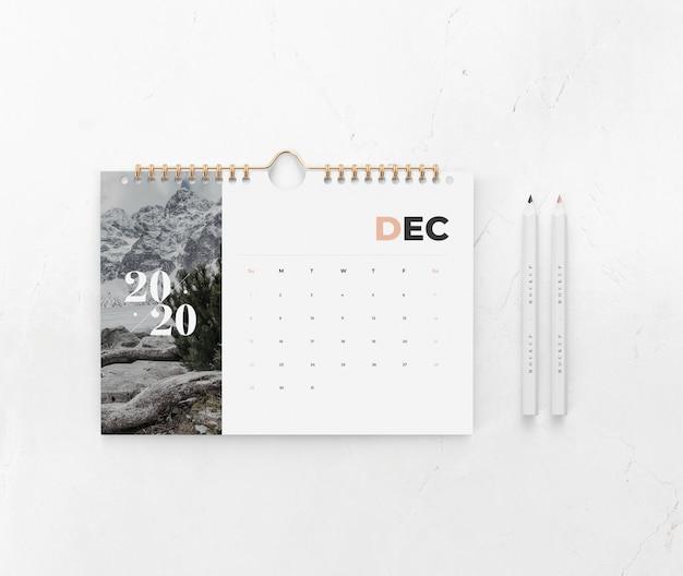 Calendario en maqueta de concepto de pared PSD gratuito