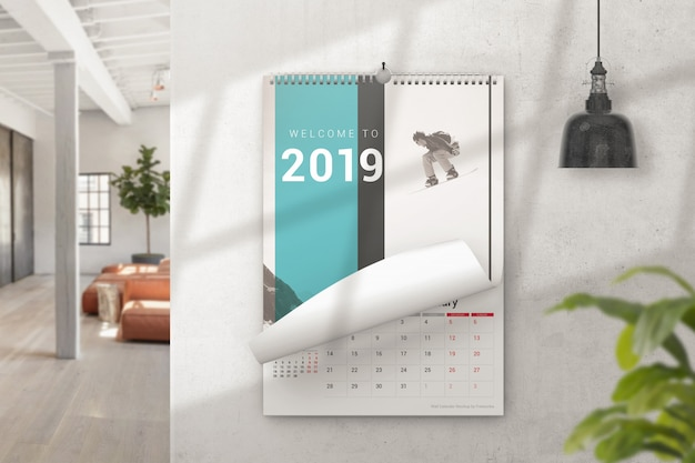 Calendario murale con mockup di pagina arricciata Psd Premium