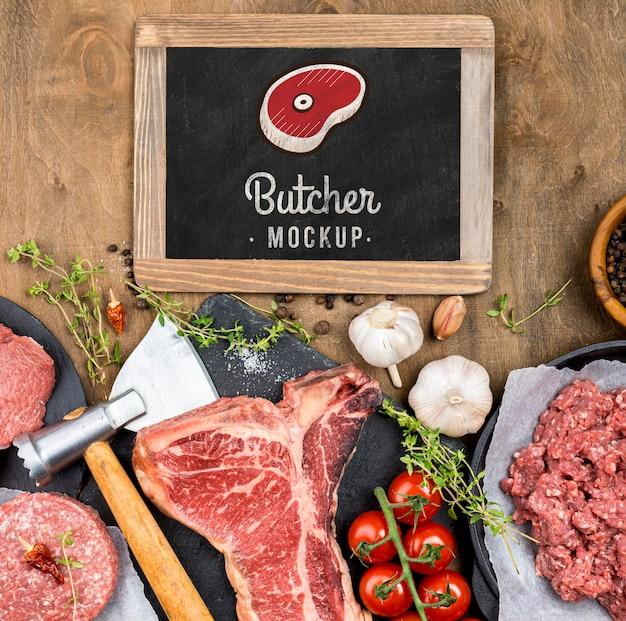 Carnicería de vista superior con carne fresca PSD gratuito