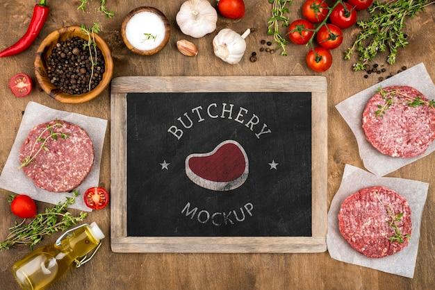 Carnicería de vista superior con carne de hamburguesas PSD gratuito