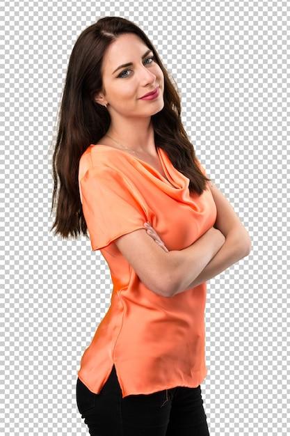 Chica joven hermosa feliz con sus brazos cruzados PSD Premium