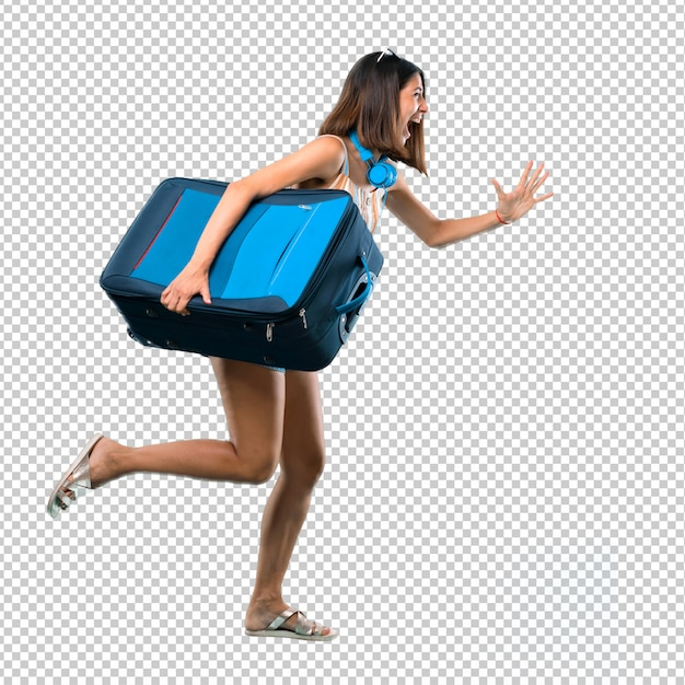 Chica viajando con su maleta corriendo rápido PSD Premium
