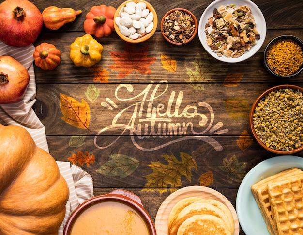 Ciao citazione d'autunno circondata da deliziosi cibi autunnali Psd Gratuite