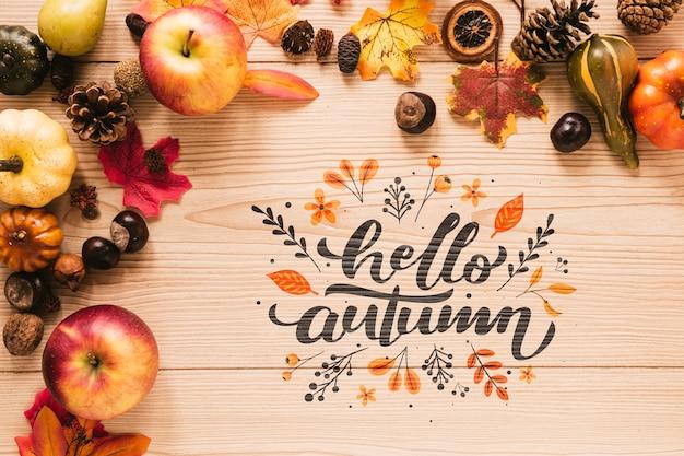 Ciao citazione d'autunno con foglie e mele Psd Gratuite