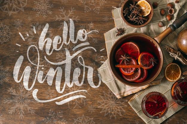 Ciao inverno e vin brulè con fettine di arance Psd Gratuite