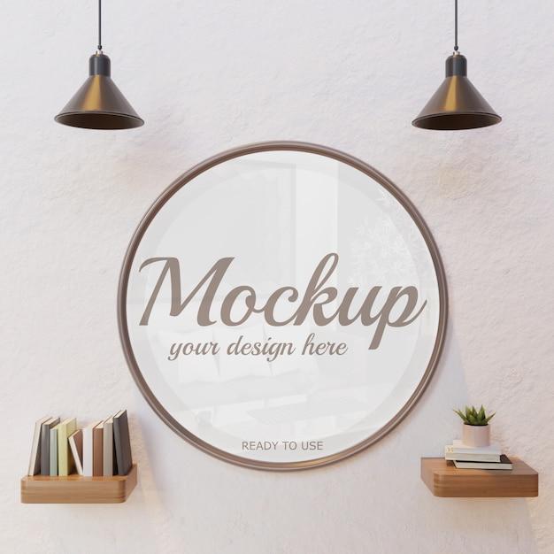 Cirkelkader mockup op witte muur onder lamp met boek wandplank Premium Psd