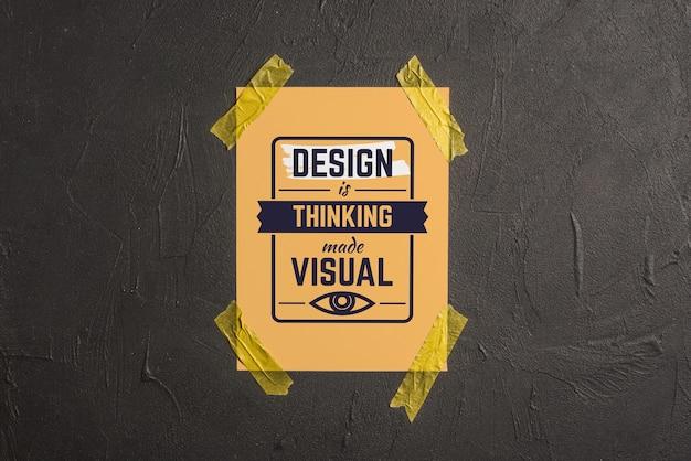 Citazione o lettering mockup sul poster incollato al muro Psd Gratuite