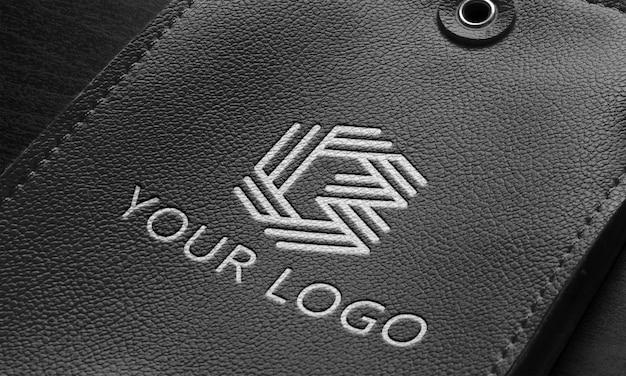 Close-up op zwart lederen logo mockup-ontwerp Premium Psd