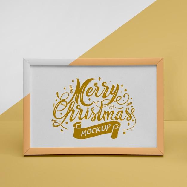 Close-up van een vrolijk kerstframe met mock-up Gratis Psd