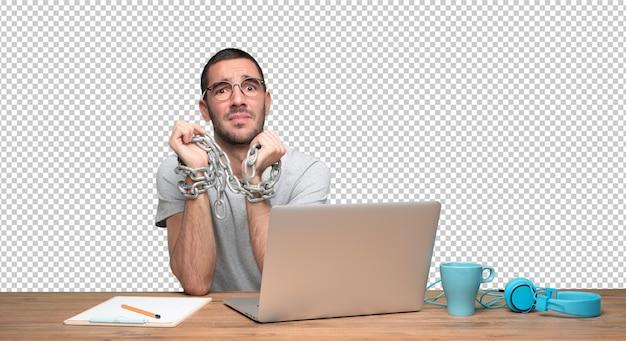 Concept van een betrokken jonge man vastgeketend aan internet Premium Psd
