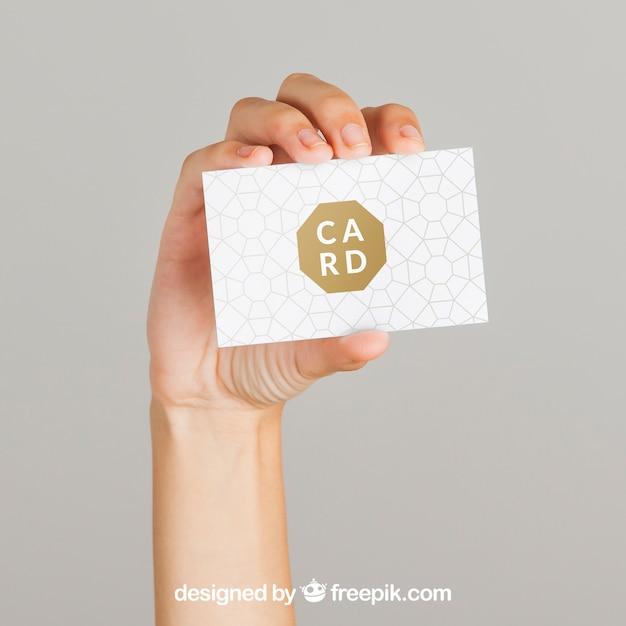 Concepto mockup de mano y tarjeta de visita PSD gratuito