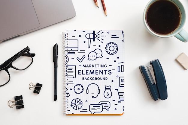 Concepto de oficina con maqueta de herramientas PSD gratuito