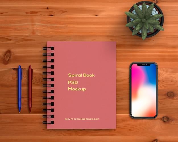 Concepto stationery con mockup de libro espiral PSD gratuito
