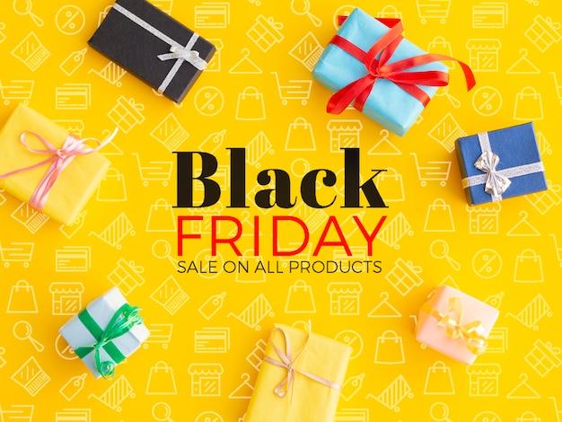 Concetto di black friday con i regali su fondo giallo Psd Gratuite