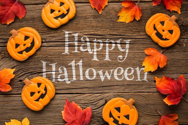 Cornice mock-up con dolcetti di halloween Psd Gratuite
