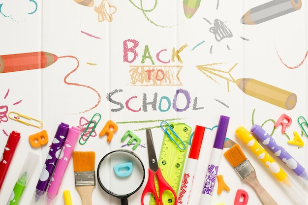 Cornice piatta con materiale scolastico Psd Gratuite