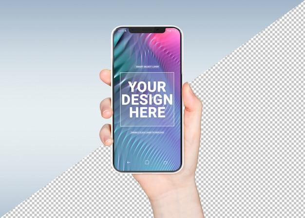 Cortar la mano de mujer con maqueta de smartphone blanco PSD Premium