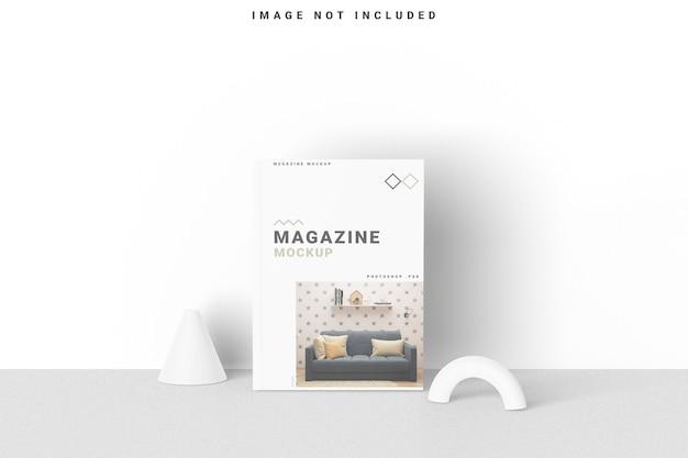 Cover magazine mockup staan op de muur Premium Psd