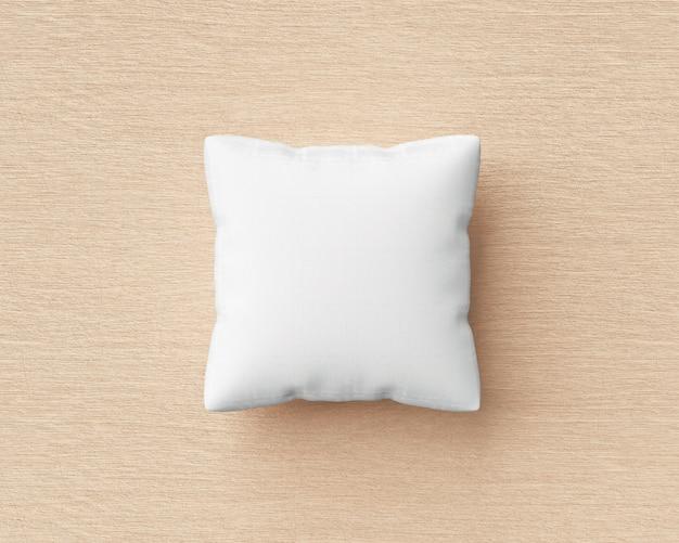 Cuscino bianco e forma quadrata sul fondo di legno del pavimento con il modello in bianco. mockup di cuscini per il design. rendering 3d. Psd Premium