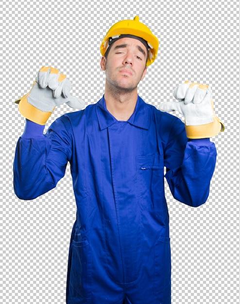 De ongerust gemaakte werkman met ontbreekt gebaar op witte achtergrond Premium Psd