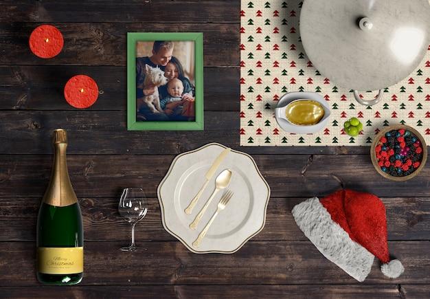 De scènemodel van de kerstmisscène op houten lijst Gratis Psd