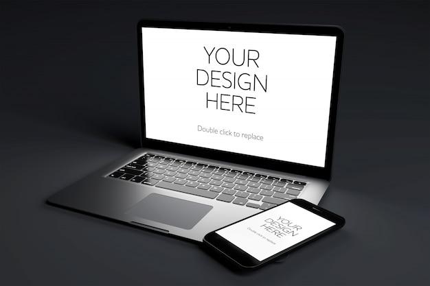 Dispositivo de computadora portátil con maqueta de pantalla en sala negra PSD Premium