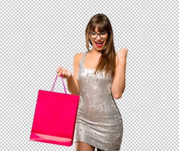 Donna che indossa un abito di paillettes Psd Premium