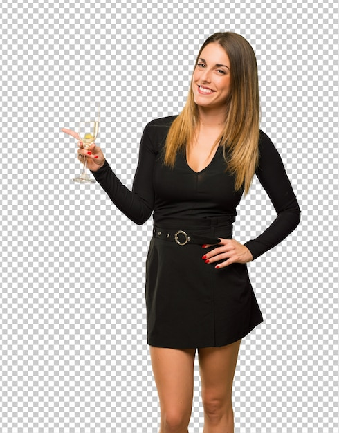 Donna con champagne che celebra il nuovo anno 2019 che indica barretta al lato Psd Premium