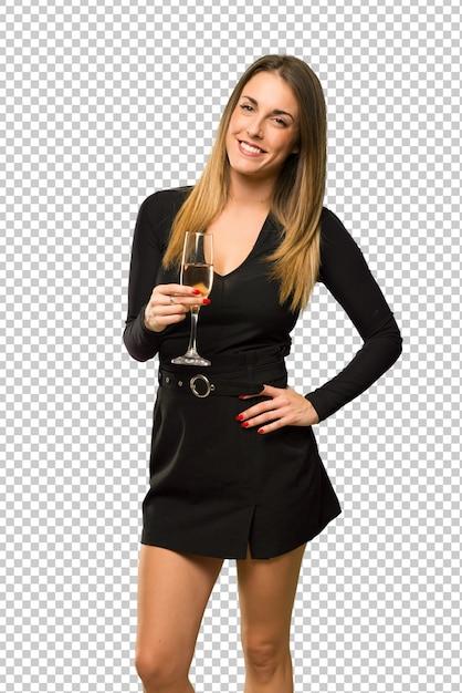 Donna con champagne festeggia il nuovo anno 2019 in posa con le braccia in anca e sorridente Psd Premium