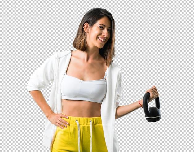 Donna sportiva con kettlebell Psd Premium