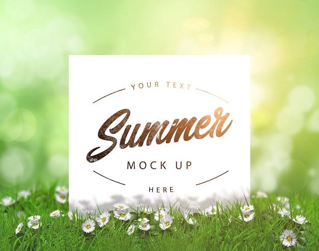 Editable verano maqueta con tarjeta en blanco ubicado en la hierba con margaritas PSD gratuito