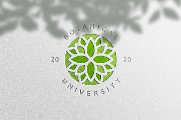 Eenvoudig logo-model in wit papier met plantenschaduw Premium Psd