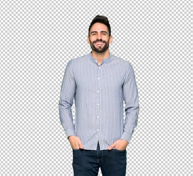 Elegante man met shirt veel glimlachend terwijl handen op borst zetten Premium Psd