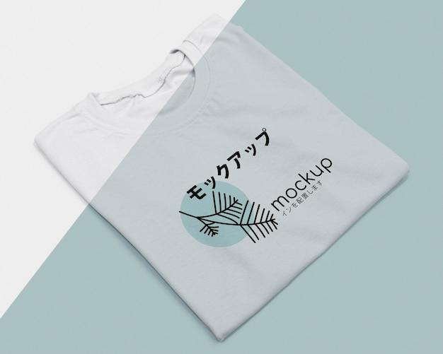 Endecha plana de maqueta de concepto de camiseta PSD gratuito