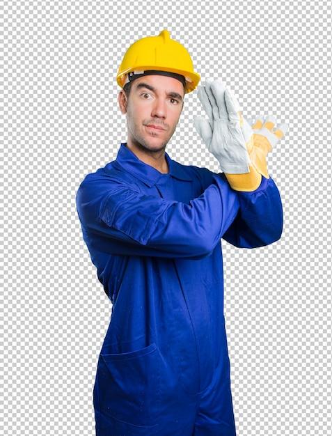 Ernstige werkman die een gebaar van verbod op witte achtergrond doet Premium Psd