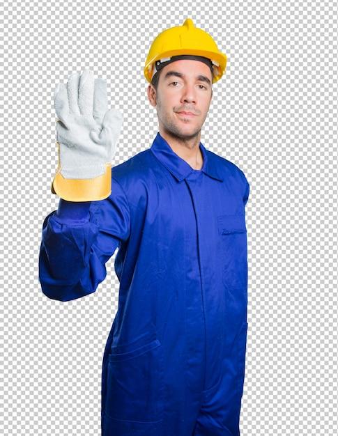 Ernstige werkman met een eindegebaar op witte achtergrond Premium Psd