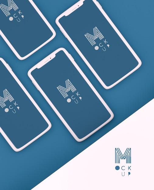 Escena azul clásica monocromática con maqueta de teléfonos PSD gratuito