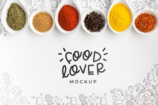 Eten liefhebber en kommen gevuld met kruiden mock-up Gratis Psd