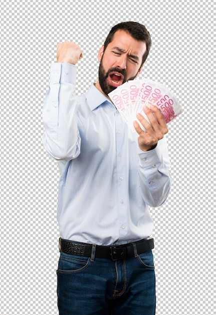 Felice bell'uomo con la barba prendendo un sacco di soldi Psd Premium